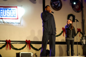 NBA 7 time Champion Robert Horry and actress Mika Kelly address the audience during a USO show at Camp Buehring, Kuwait, Dec. 14, 2011. DoD photo by D. Myles Cullen (released)